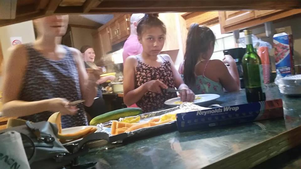 Family Cooking in a Rental Home